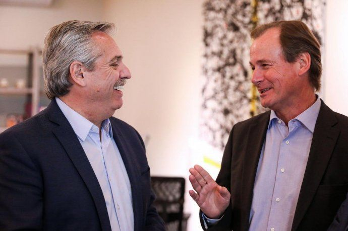 Alberto Fernández junto a Gustavo Bordet.