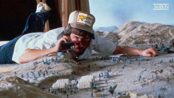 Spielberg evaluating different shots in one of the miniatures during the filming of Indiana Jones and the Raiders of the Lost Ark.
