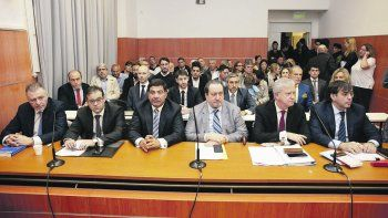 Cristóbal López, Ricardo Etchegaray y Fabián De Sousa, durante una de las audiencias del juicio.