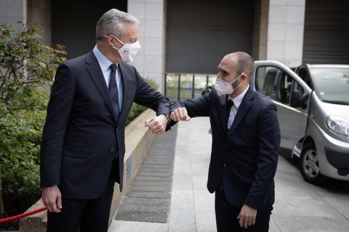 Guzmán junto al ministro de Finanzas francés
