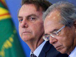 El presidente de Brasil, Jair Bolsonaro, y su superministro, Paulo Guedes.