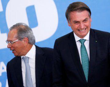 Paulo Guedes, junto a Jair Bolsonaro.