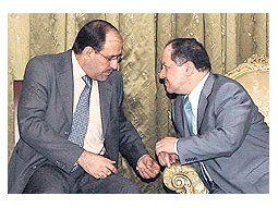El primer ministro iraquí, Nuri al-Maliki, y el líder kurdo Masud Barzani. La salida de los ministrossunitas de la coalición gobernante provoca una peligrosa parálisis política.