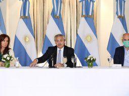 Alberto, Cristina y Larrerta en la mesa principal en Olivos.