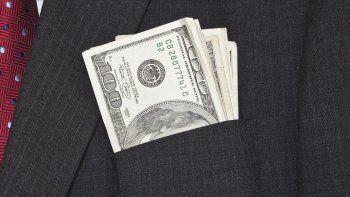 En octubre, 1,1 millón de personas comprar dólares para atesoramiento.